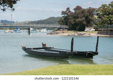 Waitangi, North Island, New Zealand-December 18,2016: Double-hulled old war canoe moored to the waterfront in Waitangi, New Zealand