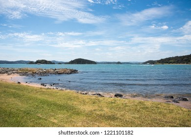 Waitangi, North Island, New Zealand-December 18,2016: Tender boat and other vessel i​n the Tasman Sea with island view in Waitangi, New Zealand
