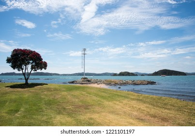Waitangi, North Island, New Zealand-December 18,2016: Remote bay with nautical equipment, scenic island view and nautical vessels in Waitangi, New Zealand
