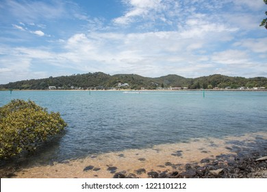 Waitangi, North Island, New Zealand-December 18,2016: Boat in the Tasman Sea with mountain greenery and waterfront view in Waitangi, New Zealand