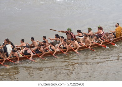WAITANGI, NORTHLAND, NEW ZEALAND - 6 FEBRUARY 2016: Maori canoe (waka) with paddlers during the Waitangi Day celebrations commemorating the treaty of New Zealand between Maori and the British Crown.