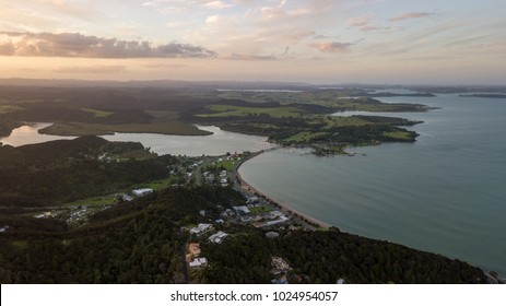 Waitangi Treaty Grounds And Paihia Town, New Zealand Bay Of Islands Panorama At Sunset.