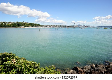 Waitemata harbour with the Sky Tower seen from the north shore city, Auckland, New Zealand