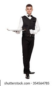 A waiter or bartender, or servant holding a silver tray and smiling. White background.