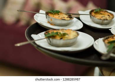 the waiter carries plates with julienne