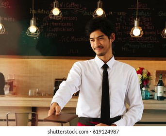 Waiter is giving bills to customer