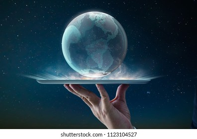 Waiter hand using digital pad holding digital glass planet earth with hologram design . Global business technologies concept. Mixed media .