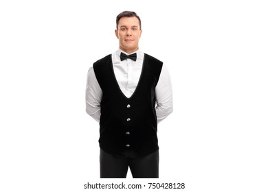Waiter with his hands behind his back isolated on white background