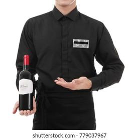 Waiter holding bottle of wine on white background