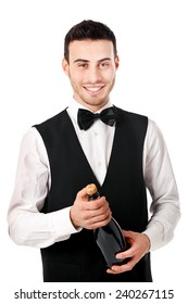 Waiter holding a champagne bottle isolated on white
