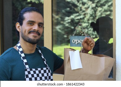 Waiter holding to go paper bag with receipt