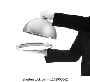 Waiter holding metal tray with lid on white background