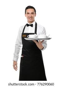 Waiter holding tray with tea set on white background