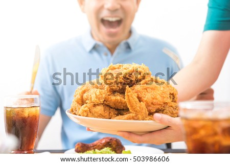 Waiter Putting Fried Chicken On Table Stock Photo Edit Now