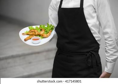 Waiter. Restaurant waiter.Young waiter at the restaurant