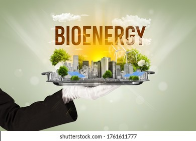 Waiter serving eco city with BIOENERGY inscription, renewabke energy concept