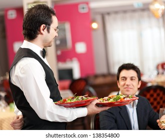 Waiter serving food to a customer