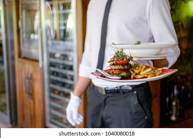 waiter serving gourmet plate