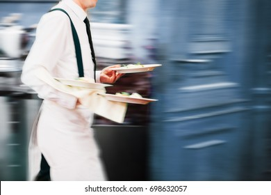 Waiter Serving In Motion On Duty in Restaurant Long Exposure | Copyspace
