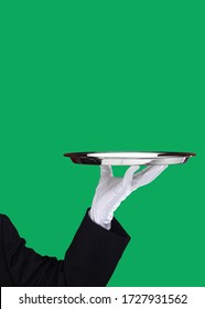 Waiter serving silver plate on green box