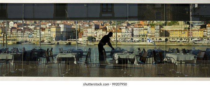 Waiter in silhouette dining in the restaurant in Porto.