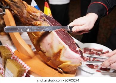 Waiter is slicing jamon