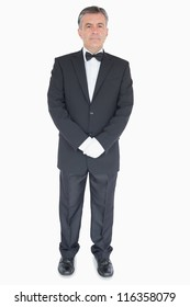 Waiter in suit standing with crossed arms