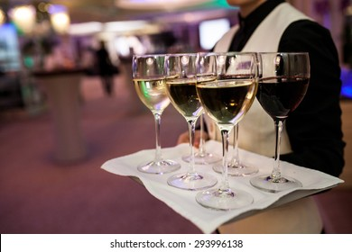 Waiter welcomes guests with sparkling wine