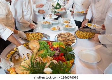 Waiters preparing dishes to serve