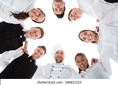Waiters and waitresses standing in circle. Isolated on white