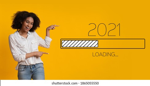 Waiting For 2021 New Year. Joyful Black Woman Pointing Finger At 2021 Loading Process Bar Standing Over Yellow Background. Anticipation, Awaiting Upcoming Better Year Concept. Panorama - Shutterstock ID 1865055550
