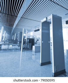 The waiting area - behind the security entrance and desk - of an airport terminal