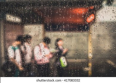 Waiting bus in the rain at taipei street