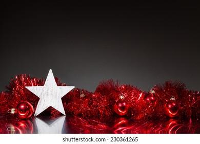 waiting for christmas - single wood star against dark background