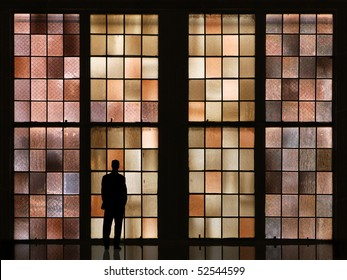 waiting man in front of colorful windows