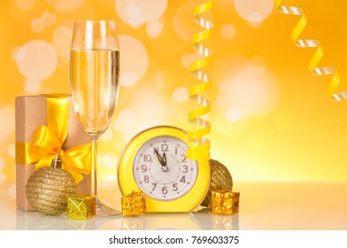 Waiting for the new year, watch, gifts, champagne, on bright yellow background