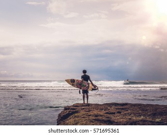 Waiting for the perfect wave / Bali surfer