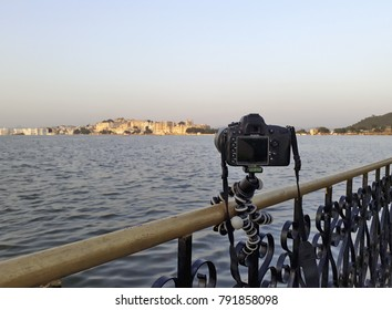 Waiting for the right light with a reflex on a small tripod attached to a railing in Udaipur, Rajasthan, India