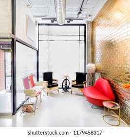 Waiting room in a modern bright beauty salon with trendy chairs and pop seats. Hair salon and make up store, barber shop and manicure interior business