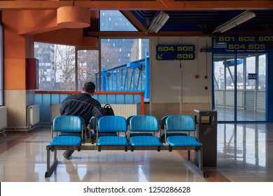 Waiting room of the Zagreb bus station, with only one person waiting.  Seventies orange and blue decor. (Izlaz=exit)