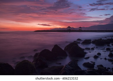 Waiting in the seashore to see this beautiful sunset in Candidasa, Bali.