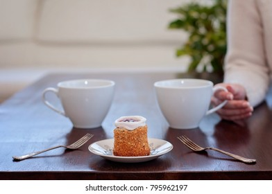 Waiting for someone in a caf'e on a table for 2: Runeberg's cake or tart is a Finnish traditional dessert and pastry