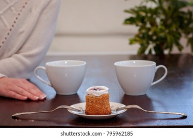 Waiting for someone in a café on a table for 2: Runeberg's cake or tart is a Finnish traditional dessert and pastry