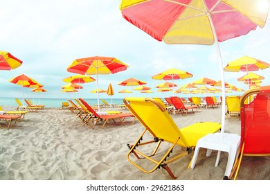 waiting for the summer - chairs and umbrellas on the beach