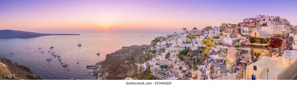Waiting for the sunset in the village of Oia in the Santorini, Greece. Santorini is an ancient volcano located in the middle of the mediterranean sea, surrounded by crystalline and refreshing waters.