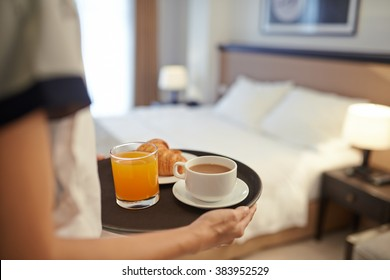 Waitress bringing breakfast to the hotel room