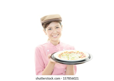 Waitress delivering meal to table