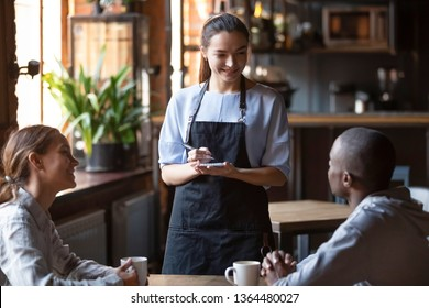 Waitress female welcoming diverse cafeteria pub guests african guy mixed race girl making order waiting staff writing wishes on notepad. Good service dining time, friends meets in public place concept