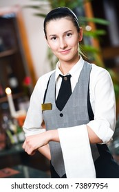 Waitress girl of commercial restaurant in uniform waiting an order