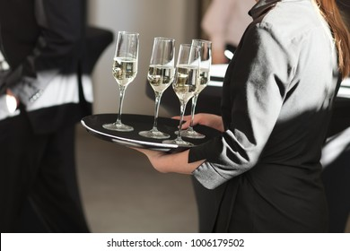 waitress at restaurant serving drink